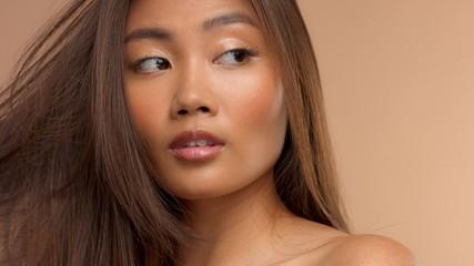 closeup portrait of asian thai japanese model watching aside