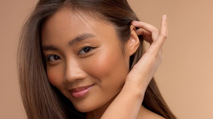 closeup portrait of asian thai japanese model take away hair from face