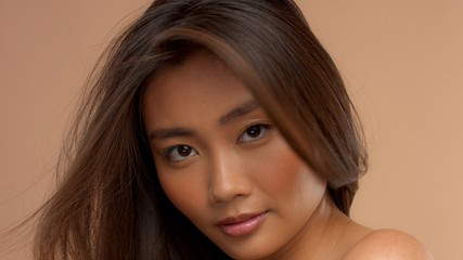 closeup portrait of asian thai japanese model with blowing hair