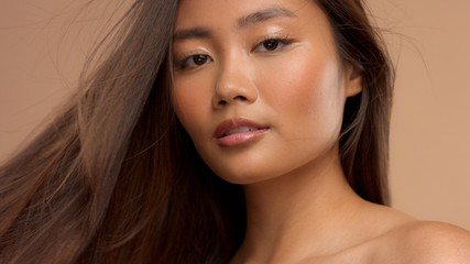 closeup portrait of asian thai japanese model with ideal straight hair blowing out