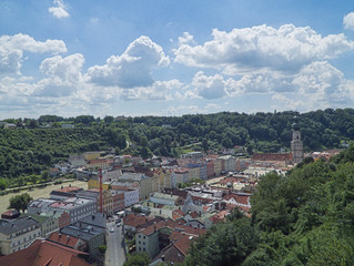 View over Burghausen towards Austria with a blue cloudy sky
