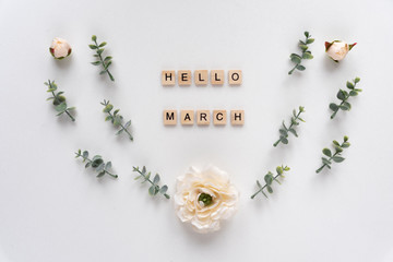 Hello March words on white marble background.