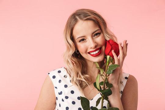 Beautiful young blonde woman wearing dress