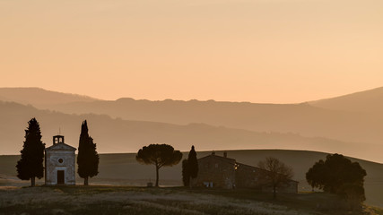 The chapel of the Madonna di Vitaleta at the first light of the day, San Quirico d'Orcia, Siena, Tuscany, Italy