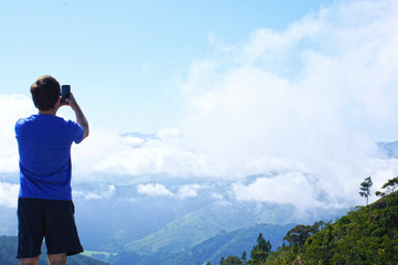 Man photographing the mountains