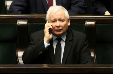 Jaroslaw Kaczynski, the leader of the ruling Law and Justice party speaks on a mobile phone during a session at the Parliament in Warsaw