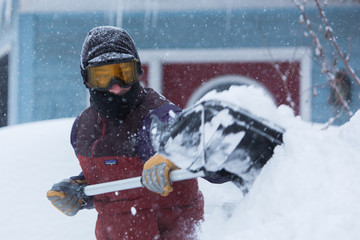 Stephen Gabris shovels snow during winter storm in Buffalo, NY