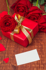 red rose and blank gift card for text