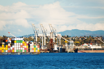 Cranes and stack of containers at port terminal