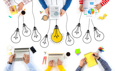 Group of Business People and Lightbulb Idea Concept .