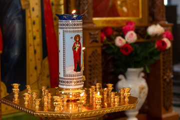The face of the Holy Virgin Mary with the baby, and around the candles are.