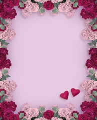 Floral frame with rose flowers and two hearts for Valentines day isolated on violet background and place for your photo or text