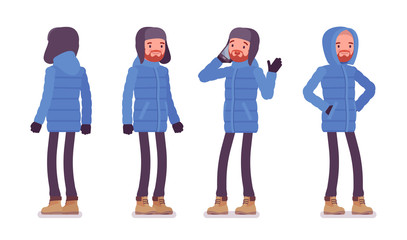 Stylish man in a blue down jacket standing