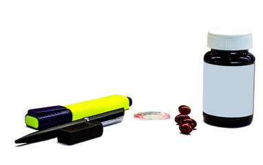 Isolate office tool and medicine on white background, Pen and highlight with brain nutrition pills on table, office syndrome, stress from working, business background, Di-cut of pill for brain
