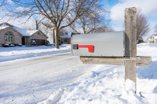A Home Mailbox buried in Snow after a Snowstorm