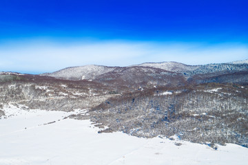 Croatian mountain nature landscape, beautiful winter panorama of woods under snow in Gorski kotar