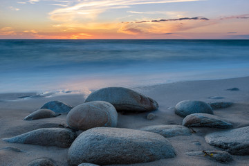 French landscape - Bretagne. A beautiful beach with rocks at sunset.