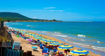 Paradisiac view of a sandy beach in Gargano. Visibles tourists