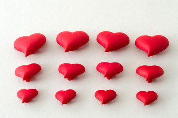 A few of little red hearts for Valentine's Day against white background