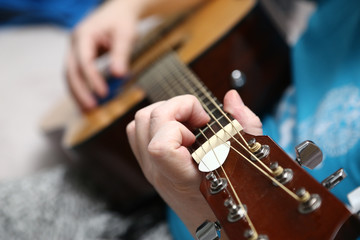 Playing guitar. The hands of a guitarist closeup and classic six-string guitar.
