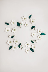 Creative layout of white flowers and plants with copy space for writing.