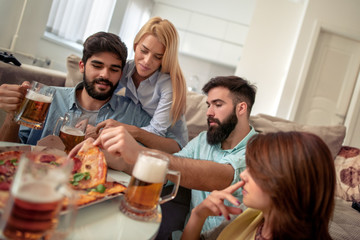Group of happy young people eating pizza