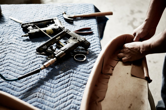upholstery craftsman working