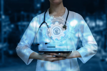 A closeup of a doctor with the medical system update sign system.