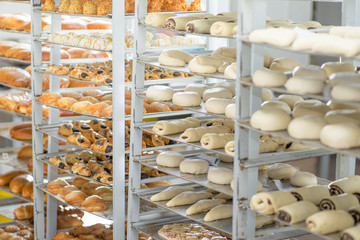 racks with finished and raw dough products in a bakery