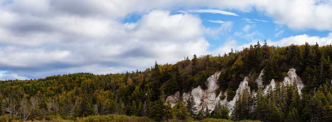 Panoramic view of a beautiful Canadian Landscape during a vibant sunny day in Fall Season. Taken in Newfoundland, Canada.