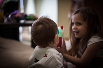 Brother playing with sister.