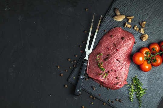 Fresh raw meat beef steak with ingredients for cooking