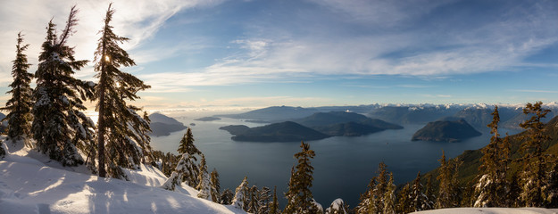 Beautiful Panoramic Canadian Landscape view during a colorful winter evening before sunset. Taken from top of Mnt Harvey, North of Vancouver, BC, Canada. Fototapete