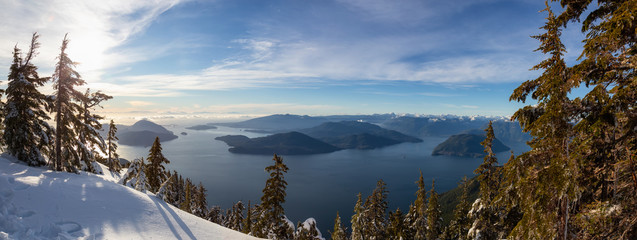 Beautiful Panoramic Canadian Landscape view during a colorful winter evening before sunset. Taken from top of Mnt Harvey, North of Vancouver, BC, Canada.