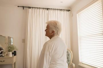 Senior woman relaxing in bedroom