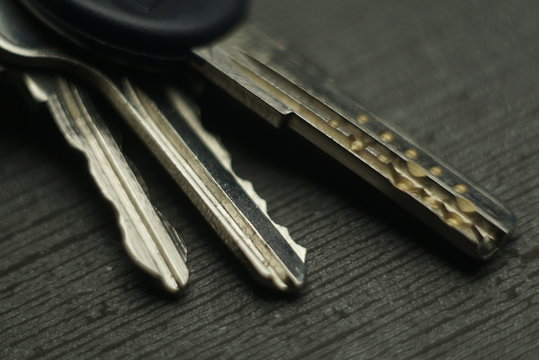 the bunch of different keys from the door locks close up