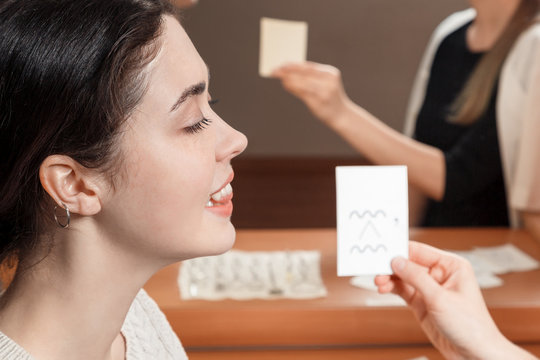 girl looking at the card says sounds