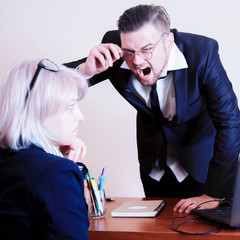 Fototapeta Bullying with an out of control boss shouting to a stressed employee.  Negative emotions, conflict and business threat concept. obraz
