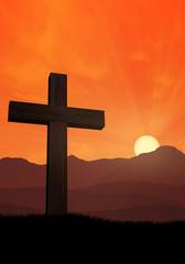 Cross of jesus in front of mountains at sunset 2