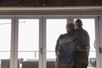 Senior couple standing together at home