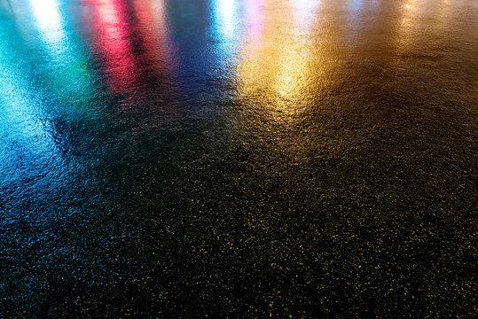 Wet colored asphalt. Road texture.