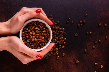 Seeds of fragrant coffee, coffee drink on a dark concrete background. It can be used as a background