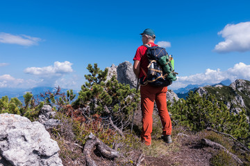 Hiker admire the mountain panorama of the peak.