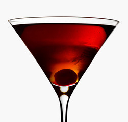 Manhattan cocktail in a martini glass on a light grey background