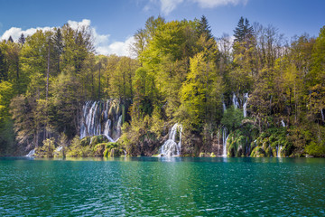 Wonderful cascades plunging in turquoise lakes and surrounded by green forests, Plitvice Lakes National Park, Croatia