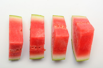Watermelon isolated on white. Sliced fresh melon peices