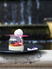 dessert made of cream and fruits in a jar