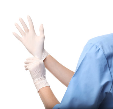 Female doctor putting on rubber gloves against white background, closeup. Medical object