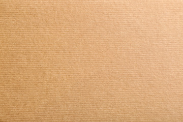 Sheet of kraft paper as background, top view. Recycling concept