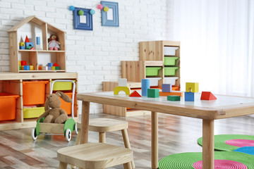 Modern child room interior with table and stools